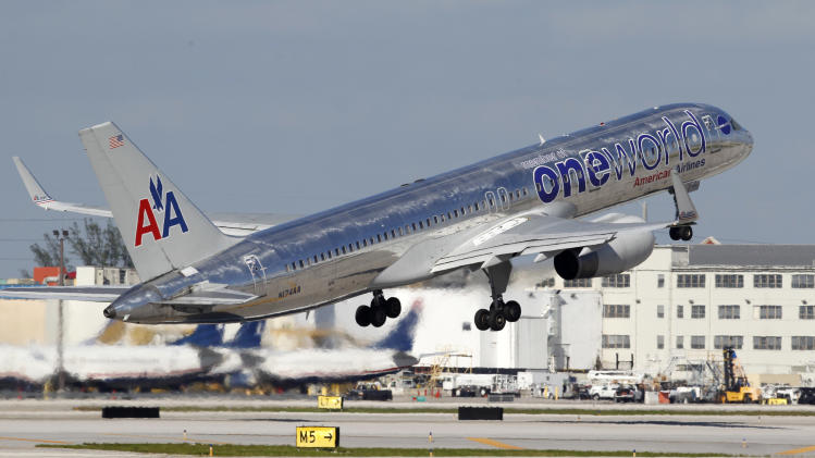 In this Thursday, Oct. 11, 2012 photo, an American Airlines Boeing 757 passenger jet takes off from Miami International Airport in Miami. AMR Corp. reports quarterly financial results on Thursday, July 18, 2013. (AP Photo/Wilfredo Lee)