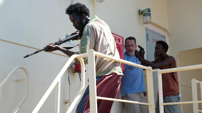 """This photo released by Sony - Columbia Pictures shows, from left, Mahat Ali, Tom Hanks and Faysal Ahmed, in a scene from the film, """"Captain Phillips,"""" releasing in the US on Friday, Oct. 11, 2013. The amateur actors of Somali descent from Minneapolis made their film debut acting as Somali pirates alongside the two-time Academy Award winner, Hanks. (AP Photo/Copyright Sony - Columbia Pictures, Jasin Boland)"""