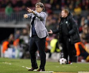 Barcelona's coach Martino gives instructions during their Champions League soccer match against Celtic in Barcelona