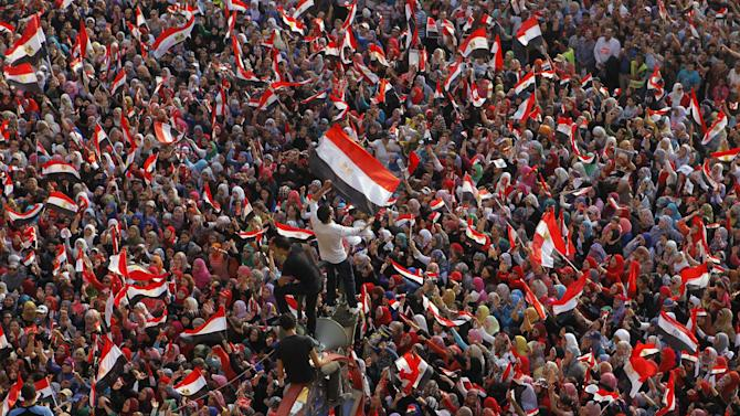 Opponents of Egypt's Islamist President Mohammed Morsi shout slogans and wave national flags in Tahrir Square in Cairo, Egypt, Tuesday, July 2, 2013. With a military deadline for intervention ticking down, protesters seeking the ouster of Egypt's Islamist president sought Tuesday to push the embattled leader further toward the edge with another massive display of people powe (AP Photo/Amr Nabil)