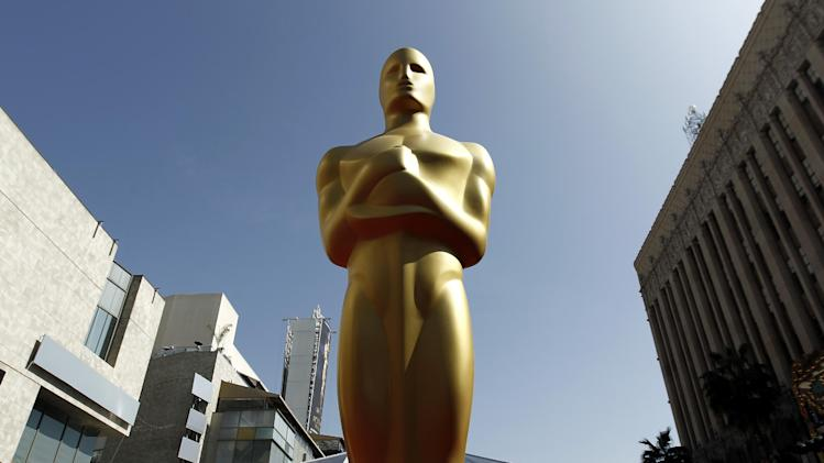 FILE - In this Feb. 25, 2012 file photo, a Oscar statue is seen on the red carpet before the 84th Academy Awards in Los Angeles. Voting begins Friday, Dec. 27, 2013, for 2014's Academy Awards nominees. Members of the Academy of Motion Picture Arts and Sciences are invited to cast secret ballots for their favorite film work from the past year until Jan. 8, 2014. (AP Photo/Matt Sayles, File)