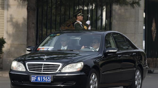 A car believed to be carrying North Korean envoy Choe Ryong Hae, leaves Beijing's Diaoyutai State Guesthouse Friday, May 24, 2013. Choe is on a fence-mending visit in China as a special envoy for North Korean leader Kim Jong Un. (AP Photo/Andy Wong)