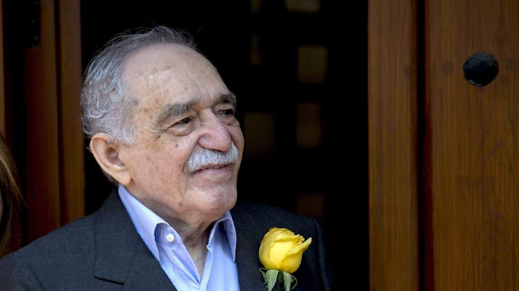 In this March 6, 2014 photo, Colombian Nobel Literature laureate Gabriel Garcia Marquez greets fans and reporters outside his home on his 87th birthday in Mexico City. Garcia Marquez died Thursday April 17, 2014 at his home in Mexico City. The author's magical realist novels and short stories exposed tens of millions of readers to Latin America's passion, superstition, violence and inequality. (AP Photo/Eduardo Verdugo)