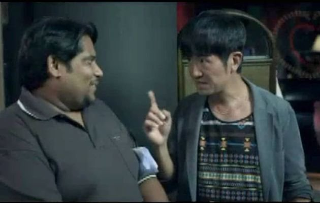 Actor Adrian Pang played a Chinese director opposite actor Vadi Pvss who played an Indian porn actor in the film. (Screengrab of the film trailer)