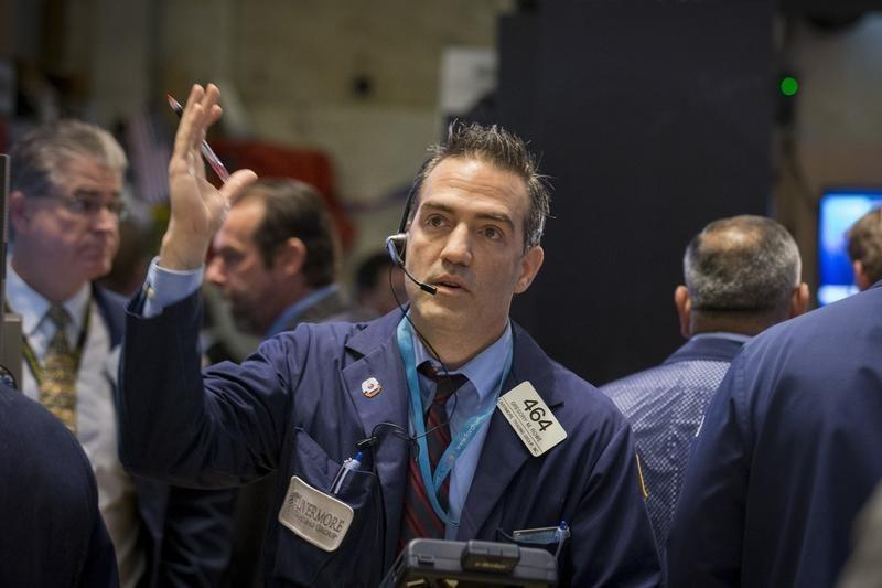 Wall St. ends up slightly as focus turns to earnings