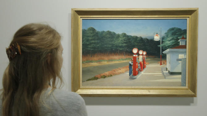 "A woman looks at ""Gas 1940"" as part of the retrospective of Edward Hopper, one of the great American 20th century artists at Paris' Grand Palais Museum, in Paris, Monday, Oct. 8, 2012.  This major Hopper retrospective reveals that the 20th century painter known for his rendering of American life, also drew inspiration from France. (AP Photo/Francois Mori)"