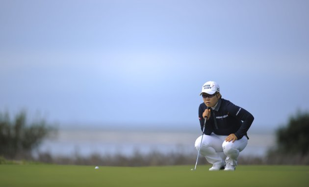Korea's Jiyai Shin lines up her putt during the delayed second round of play on day three of the Women's British Open at the Royal Liverpool Golf Club, Hoylake, north western England, Saturday Sept. 15, 2012. (AP Photo/PA, Jon Buckle) UNITED KINGDOM OUT NO SALES NO ARCHIVE