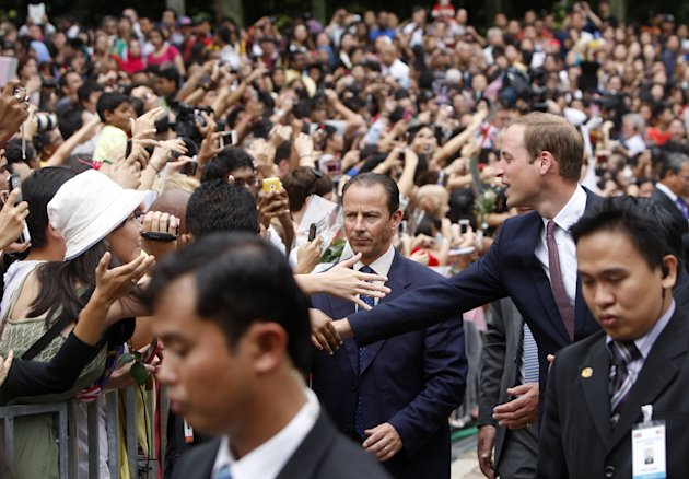 Britain's Prince William, right, the Duke of Cambridge, shakes hand with well-wishers as he attends a cultural event at KLCC park in Kuala Lumpur, Malaysia, Friday, Sept. 14, 2012. (AP Photo/Lai Seng Sin)