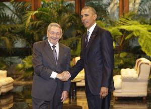 Cuban President Raul Castro, left, shakes hands with …