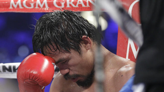 Manny Pacquiao, from the Philippines, sits in his corner following the tenth round of his WBO welterweight title fight against Timothy Bradley, from Palm Springs, Calif., Saturday, June 9, 2012, in Las Vegas. Bradley won the bout by split decision. (AP Photo/Julie Jacobson)