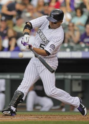 Rosario, Nelson, Cuddyer homer, Rockies win