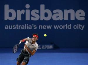 Roger Federer of Switzerland serves against Jarkko Nieminen of Finland during their men's singles match at the Brisbane International tennis tournament in Brisbane