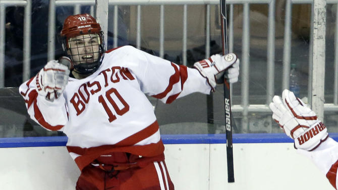 Boston University's Danny O'Regan celebrates his game-winning goal against Yale in the overtime period of an NCAA college hockey regional semifinal game in Manchester, N.H., Friday, March 27, 2015. Boston University won 3-2 in overtime. (AP Photo/Elise Amendola)