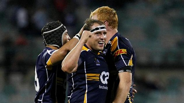 Australia's ACT Brumbies Ben Alexander (C) celebrates with Colby Faingaa (L) and Peter Kimlin