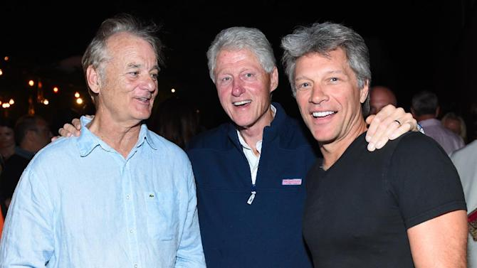 "*EXCLUSIVE* IMAGE DISTRIBUTED FOR OPEN ROAD FILMS - Actor Bill Murray, left, former U.S. President Bill Clinton, center, and musician Jon Bon Jovi attend the Hamptons Sneak Screening of Open Road Films' ""Rock the Kasbah"" after party on Friday, Aug. 28, 2015 in East Hampton, N.Y. (Photo by Scott Roth/Invision for Open Road Films/AP Images)"