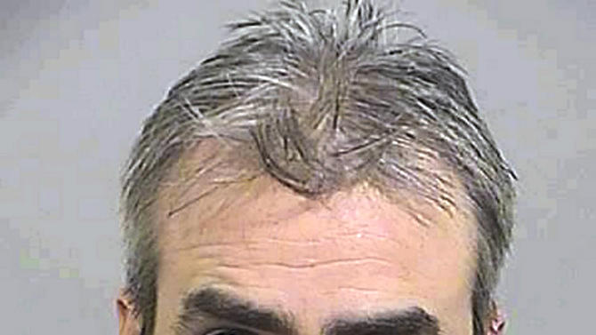 This 2007 booking photo provided by the Cumberland County Sheriff's Department shows Sidney Kilmartin.   The attorney for Kilmartin plans to use an insanity defense when he is tried on charges he mailed cyanide to a man in England who used it to kill himself, court documents say. The 52-year-old Windham man has pleaded not guilty to charges of mailing cyanide that resulted in the death of Andrew Denton, a depressed 49-year-old man in Hull, England who was found dead on Dec. 31, 2012. (AP Photo/Cumberland County Sheriff's Department)