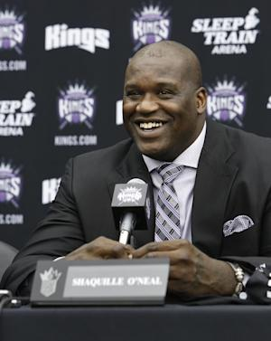 """FILE - In this Sept. 24, 2013 file photo, Shaquille O'Neal smiles during a news conference where he was welcomed as one of the new minority owners of the Sacramento Kings in Sacramento, Calif. O'Neal said in an interview on Monday, March 3, 2014, that he's seeking redemption for """"Shaq Fu,"""" his infamous 2-D brawler originally released in 1994 that's now considered to be among the worst games ever made. The four-time NBA champion is launching a crowdfunding campaign to create a """"Shaq Fu"""" follow-up called """"Shaq Fu: A Legend Reborn."""" (AP Photo/Rich Pedroncelli, file)"""