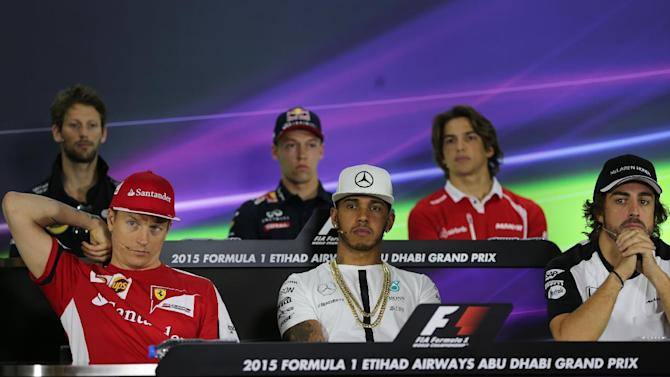 Bottom row left to right, Ferrari's Finnish driver Kimi Raikkonen, Mercedes AMG Petronas F1 Team's British driver Lewis Hamilton, McLaren Honda's Spanish driver Fernando Alonso, and top row left to right, Lotus F1 Team's French driver Romain Grosjean, Infiniti Red Bull Racing's Russian driver Daniil Kvyat and Manor F1 Team's Spanish driver Roberto Merhi, attend a press conference at the Yas Marina racetrack in Abu Dhabi, United Arab Emirates, Thursday, Nov. 26, 2015. The Emirates Formula One Grand Prix will take place on Sunday. (AP Photo/Kamran Jerbeili)