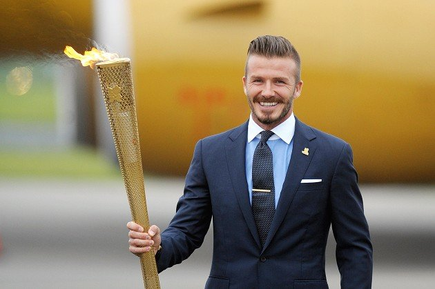 David Beckham with the torch during the ceremony to mark the arrival of the Olympic flame, at RNAS Culdrose, Cornwall