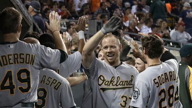 Moss has 2 HRs, 6 RBIs to lead A's to 14-4 win