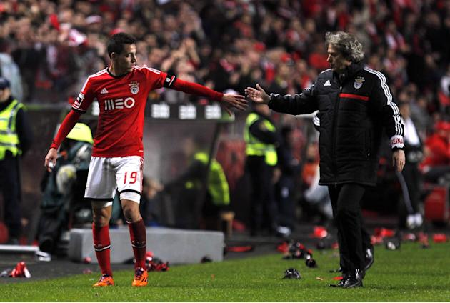 Benfica's Rodrigo, left, from Spain, is congratulated by his coach Jorge Jesus as he leaves the pitch during the Portuguese league soccer match between Benfica and Porto at Benfica's Luz stadi
