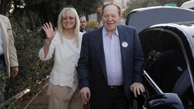 American businessman Sheldon Adelson, who has said he will donate millions to Republican presidential candidate and former Massachusetts Gov. Mitt Romney's campaign, walks with his wife Miriam Ochsorn after Romney delivered a speech in Jerusalem, Sunday, July 29, 2012. (AP Photo/Charles Dharapak)