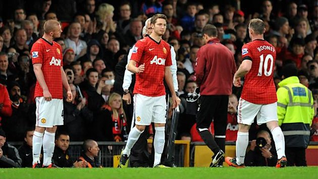 Ryan Tunnicliffe, left, prepares to come on (PA Photos)