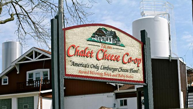 "This April 2013 photo shows the Chalet Cheese Co-op in Monroe, Wis., which bills itself as ""America's only Limburger cheese plant."" Limburger is known as a foul-smelling cheese but the local production is a point of pride in the tranquil town of Monroe. (AP Photo/Niamh O'Neill-Culhane)"