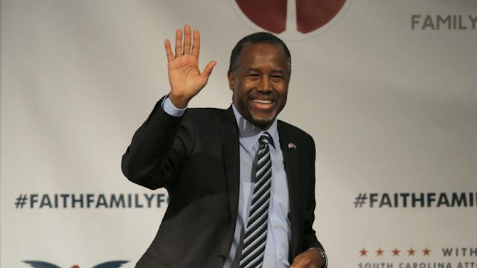U.S. Republican presidential candidate Ben Carson waves after speaking during the Faith and Family Presidential Forum at Bob Jones University in Greenville