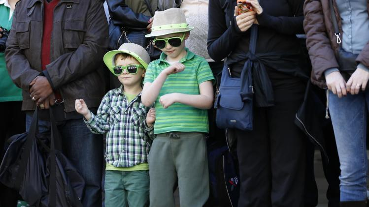 Spectators watch the St Patrick's Day parade in central London