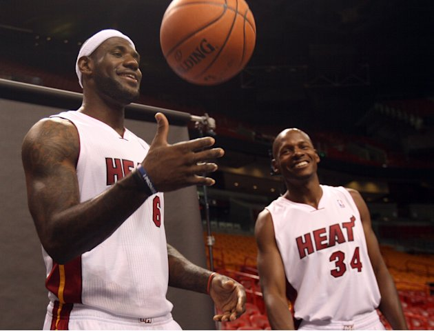 Miami Heat basketball players LeBron James, left,  and Ray Allen wait for their turn to have their pictures taken during the team's NBA media day in Miami, Friday, Sept. 28, 2012.  (AP Photo/Wilfr