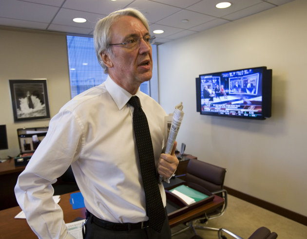 FILE- In this Dec. 3, 2008 file photo, Les Hinton, Chief Executive Officer of Dow Jones & Co. is seen at the Dow Jones New York offices. Dow Jones confirms on Friday, July 15, 2011, that Hinton will r