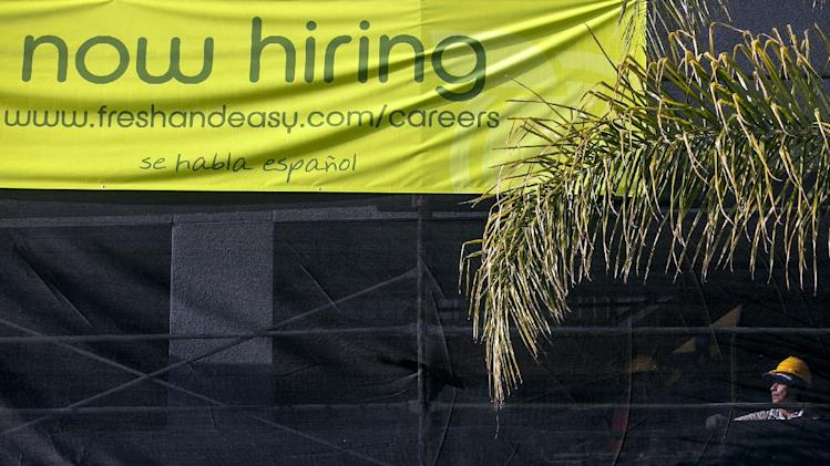 This Friday, Dec. 7, 2012, photo, shows a construction worker at a new site for a future Fresh & Easy supermarket in Los Angeles. The average number of people seeking U.S. unemployment benefits in December fell to the lowest level since March 2008, a sign that the job market is healing. (AP Photo/Damian Dovarganes)