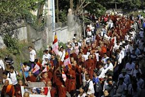 Buddhist monks take part in a protest in support of demonstrators who were injured during a copper mine riot, in Yangon