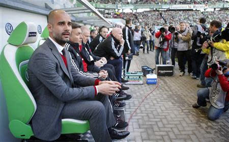 Bayern Munich head coach Pep Guardiola of Spain waits for the start of the German first division Bundesliga soccer match against Wolfsburg in Wolfsburg