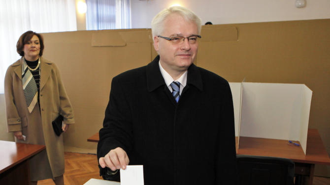 Croatia's president Ivo Josipovic casts his ballot at a polling station in Zagreb, Croatia, Sunday, Jan. 22, 2012. Croatians vote Sunday in a nationwide referendum on whether to join the European Union, a test of how much the debt-stricken 27-nation bloc has lost its appeal among potential new members. (AP Photo/Darko Bandic)
