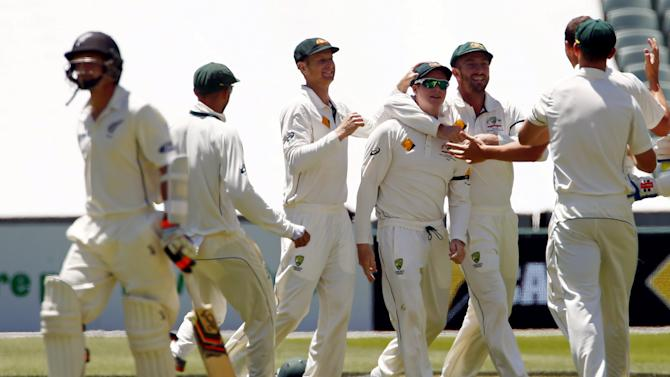 Australia's captain Steve Smith celebrates with team mates after taking a catch to dismiss New Zealand's Bradley-John Watling for seven runs during the third day of the third cricket test match at the Adelaide Oval, in South Australia