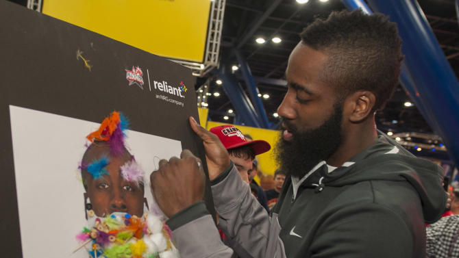 """IMAGE DISTRIBUTED FOR RELIANT - Houston Rockets guard James Harden signs the winner of the """"Build the Beard"""" contest during the NBA All-Star Jam Session sponsored by Reliant, Saturday, Feb. 16, 2013, in Houston. (Dave Einsel/AP Images for Reliant)"""