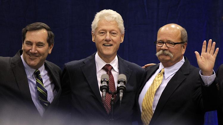 "Former President Bill Clinton, center, poses with Indiana Democratic Senate candidate Joe Donnelly, left, and Indiana Democratic gubernatorial candidate John Gregg, right, before Clinton spoke at ""Hoosier Common Sense"" rally in Indianapolis, Friday, Oct. 12, 2012.  (AP Photo/Michael Conroy)"