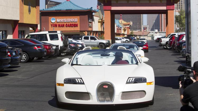 WBC/WBA welterweight champion Floyd Mayweather Jr. of the U.S. arrives in a Bugatti Veyron Grand Sport Vitesse during a media day in Las Vegas