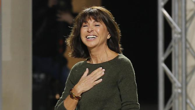 French fashion designer Veronique Nichanian reacts at the end of her Men's fall-winter 2013-2014 fashion collection presented in Paris, Saturday Jan. 19, 2013. (AP Photo/Jacques Brinon)