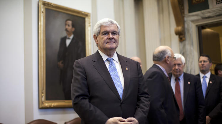 Republican presidential candidate, former House Speaker Newt Gingrich waits to be introduced for a speech on the floor of the Oklahoma State Legislature in Oklahoma City, Okla., Tuesday, Feb. 21, 2012.  (AP Photo/Evan Vucci)