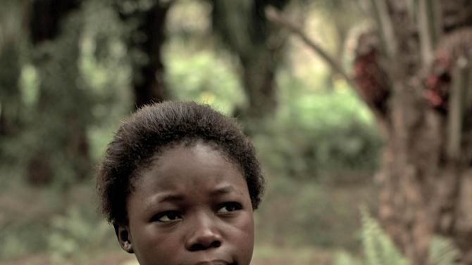"""FILE - This undated file image released by Item 7 shows Rachel Mwanza in a scene from """"War Witch."""" Mwanza has been granted a visa to travel from the Congo for the Academy Awards. The film was nominated for an Academy Award for best foreign picture on Jan. 10, 2013.  The 85th Academy Awards will air live on Sunday, Feb. 24.  (AP Photo/Item 7, file)"""