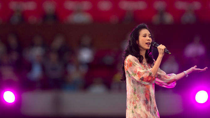 Hong Kong singer Karen Mok performs during the Rock Records' 30th Anniversary Beijing Concert in China's National Stadium, also known as the bird's nest, in Beijing, China, Sunday, May 1, 2011. (AP Photo/Alexander F. Yuan)