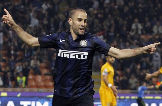 Inter Milan's Palacio celebrates after scoring a second goal against Hellas Verona during their Italian Serie A soccer match in Milan