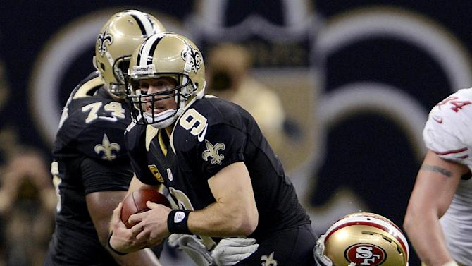 New Orleans Saints quarterback Drew Brees (9) is sacked by San Francisco 49ers outside linebacker Aldon Smith (99) in the second half of an NFL football game in New Orleans, Sunday, Nov. 25, 2012. (AP Photo/Bill Feig)