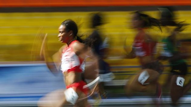 English Gardner of the U.S. (L) runs in her women's 100 metres heats during the IAAF World Athletics Championships at the Luzhniki stadium in Moscow August 11, 2013 (Reuters)
