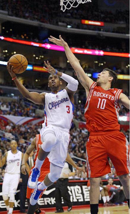 Los Angeles Clippers guard Chris Paul (3) shoots as Houston Rockets forward Carlos Delfino, of Aregentina, defends during the first half of their NBA basketball game, Wednesday, Feb. 13, 2013, in Los