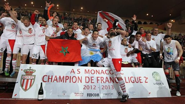 Monaco's players celebrate after winning the L2 championship (AFP)