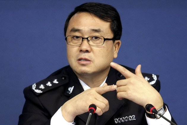 FILE - In this Oct. 21, 2008 file photo, then Chonqing city police chief Wang Lijun speaks during a press conference in Chongqing, southwestern China. The former police chief at the heart of China's biggest political scandal in years has been charged with defection, power abuse, and bribe taking, state media reported Wednesday, Sept. 5, 2012, indicating the turbulent affair is moving closer toward a resolution before the nation transitions to a new generation of leaders this fall. (AP Photo, File) CHINA OUT
